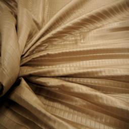 Tissu matelassé beige