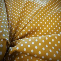 Tissu coton moutarde à pois blanc